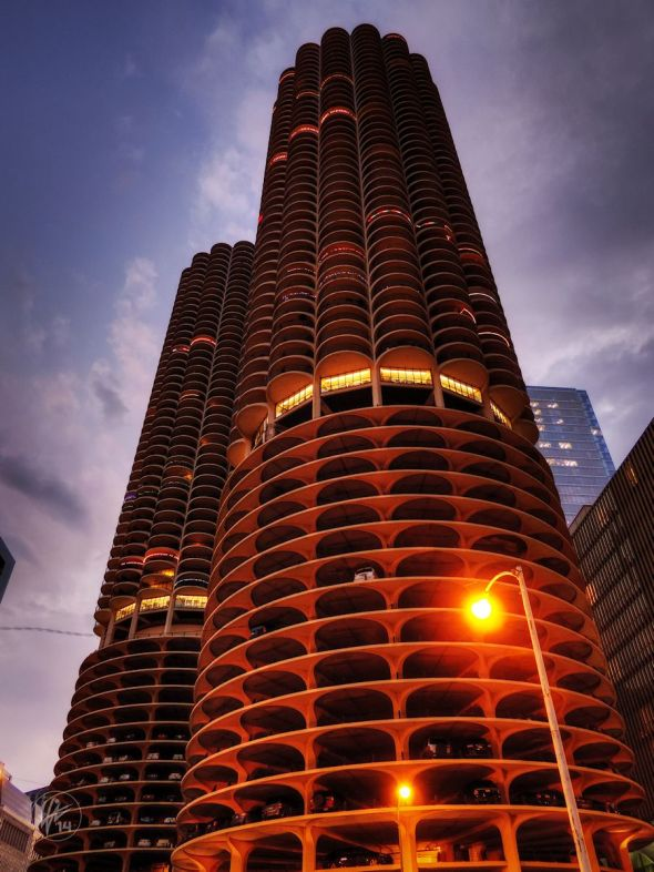 These are the iconic, twin, corncob-shaped towers of the Marina City building complex in Chicago, IL at twilight.