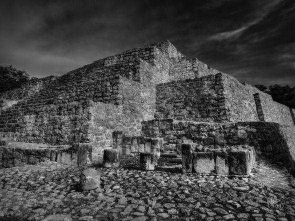 This is one of the Mayan pyramids located at the archaeological site known as Dzibilchaltun in the state of Yucatan, Mexico.