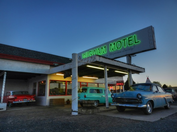 A '57 Ford 300, a '52 Ford Customliner and a '55 Ford Country Sedan Wagon are three of the several classic cars parked at the Wigwam Motel in Holbrook, AZ. The Wigwam Motel was the inspiration for the Cozy Cone Motel in Disney's animated movie Cars.